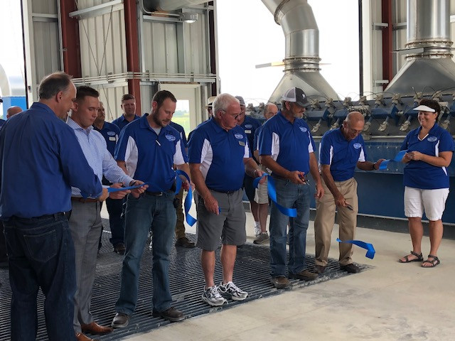 Officials cut the ribbon at the brand new PC Co-op elevator near Chenoa last summer / CIFN file photo.