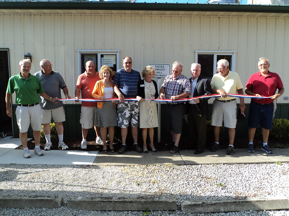 Township officials and others hold a ribbon cutting Thursday night for the new Yates Township Hall / CIFN photo.