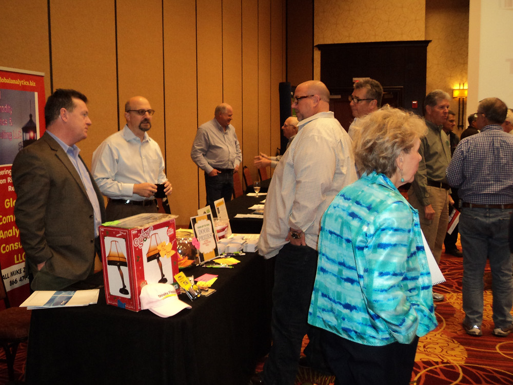 People visit at the Farm Assets Conference in Normal this week / CIFN photo.