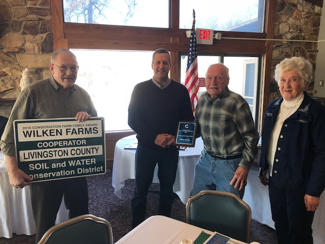 Wilken Farms of Chatsworth receives the Conservation Farm Family Award in Pontiac Thursday / CIFN photo.