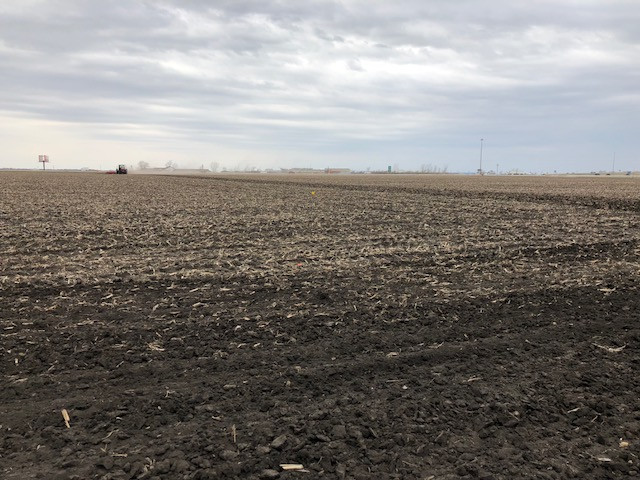 A farmer works ground west of Pontiac Friday afternoon of last week / CIFN photo.