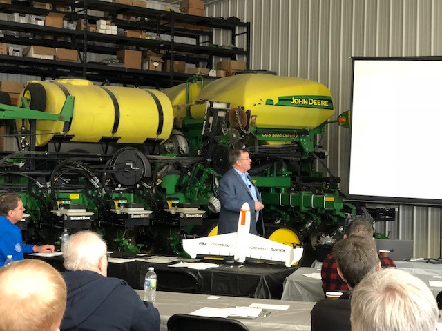 Chad Colby speaks at a meeting hosted by RA Seeding Solutions near Melvin on Friday / CIFN photo.