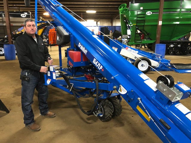 Sean Brand of Brandt is shown at the Midwest Ag Expo last month near his company display / CIFN photo.