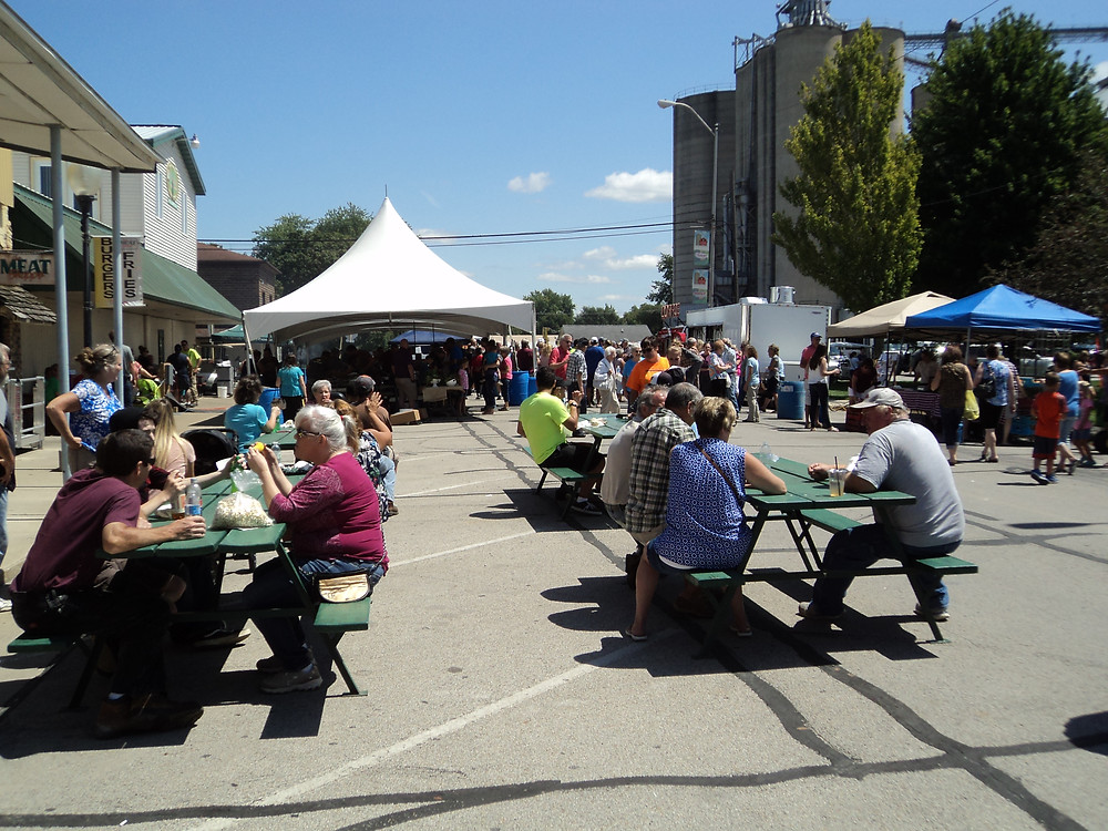 """People enjoy """"A Local Taste: Flavors from the Farm"""" in downtown Fairbury Saturday / CIFN photo."""