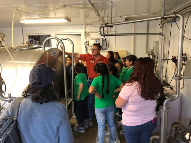 Livingston County Farm Bureau President Jason Bunting helps give tours of Kilgus Farmstead last week / CIFN photo.
