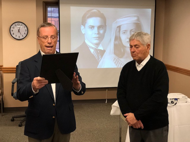 Pontiac Mayor Bob Russell (left) reads a proclamation in honor of Frank Panno (right) / EOCI photo.