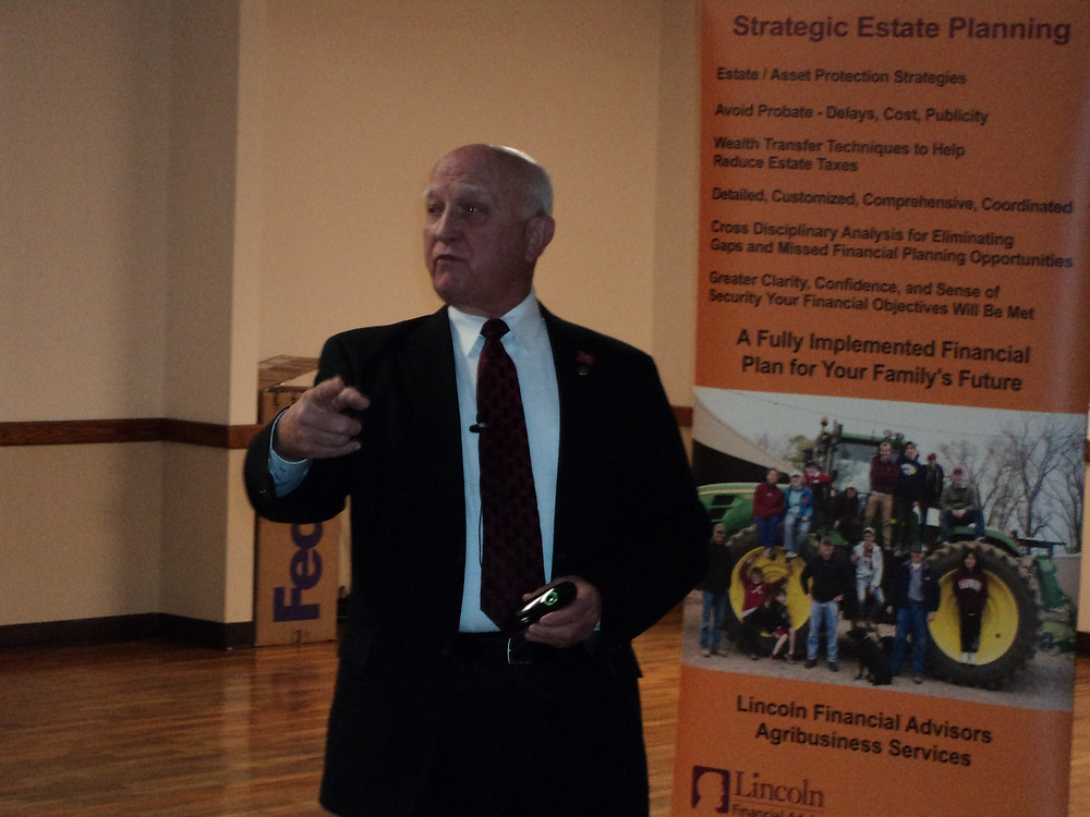 Dr. Ron Hanson speaks to a crowd in Savoy on Tuesday / CIFN photo.