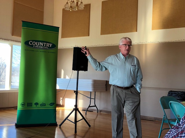 Doug Yoder of COUNTRY Financial presents information to farmers in Fairbury last week / CIFN Photo.