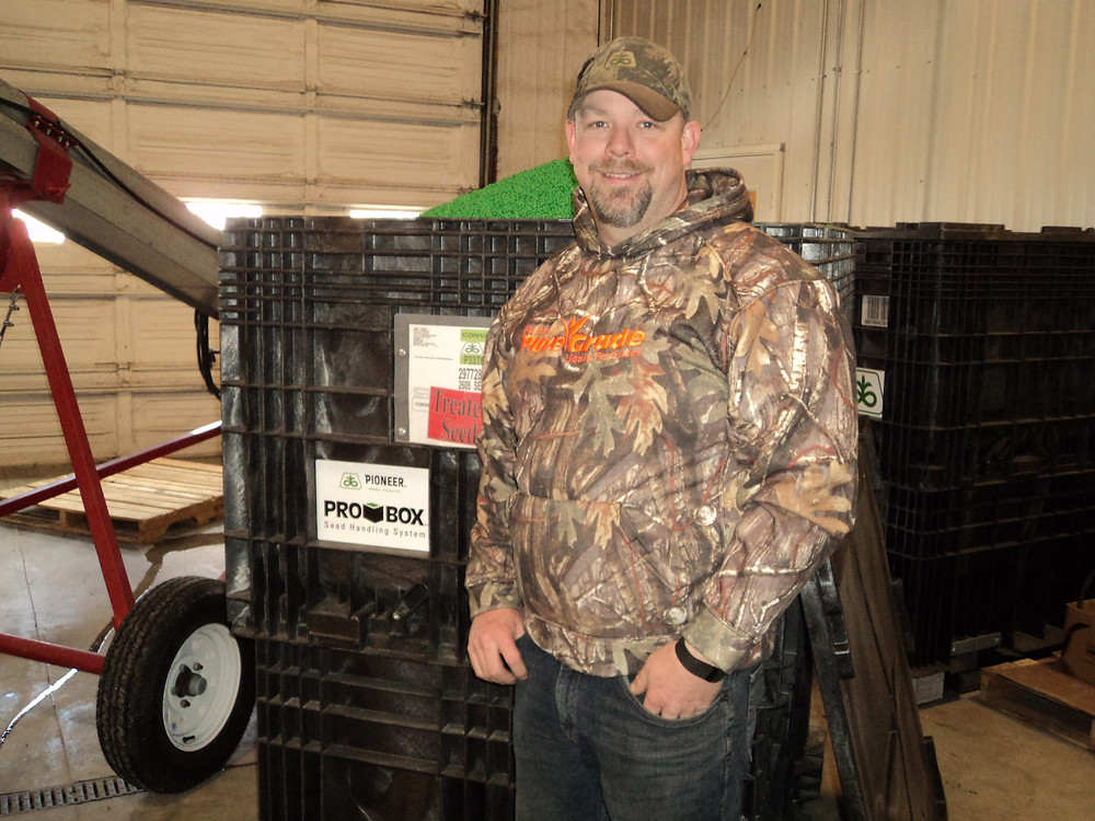 Dean Atkins treats seed in the shop of Atkins Seed Service recently / CIFN photo.