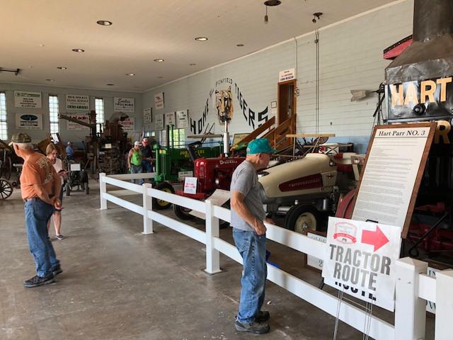 Visitors enjoy exhibits at Historic Farm Days in Penfield Thursday morning / CIFN photo.