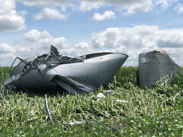 Grain bins were tossed into a nearby field from a possible tornado near Chatsworth Wednesday / CIFN photo.