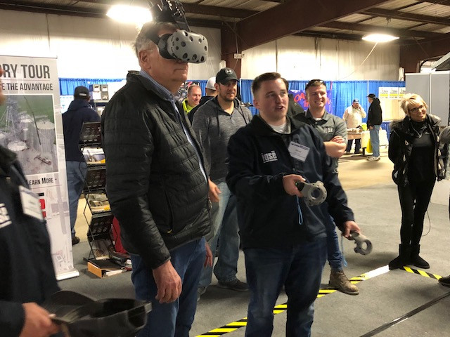 Virtual reality is featured at one of the booths at the Midwest Ag Expo this week / CIFN photo.