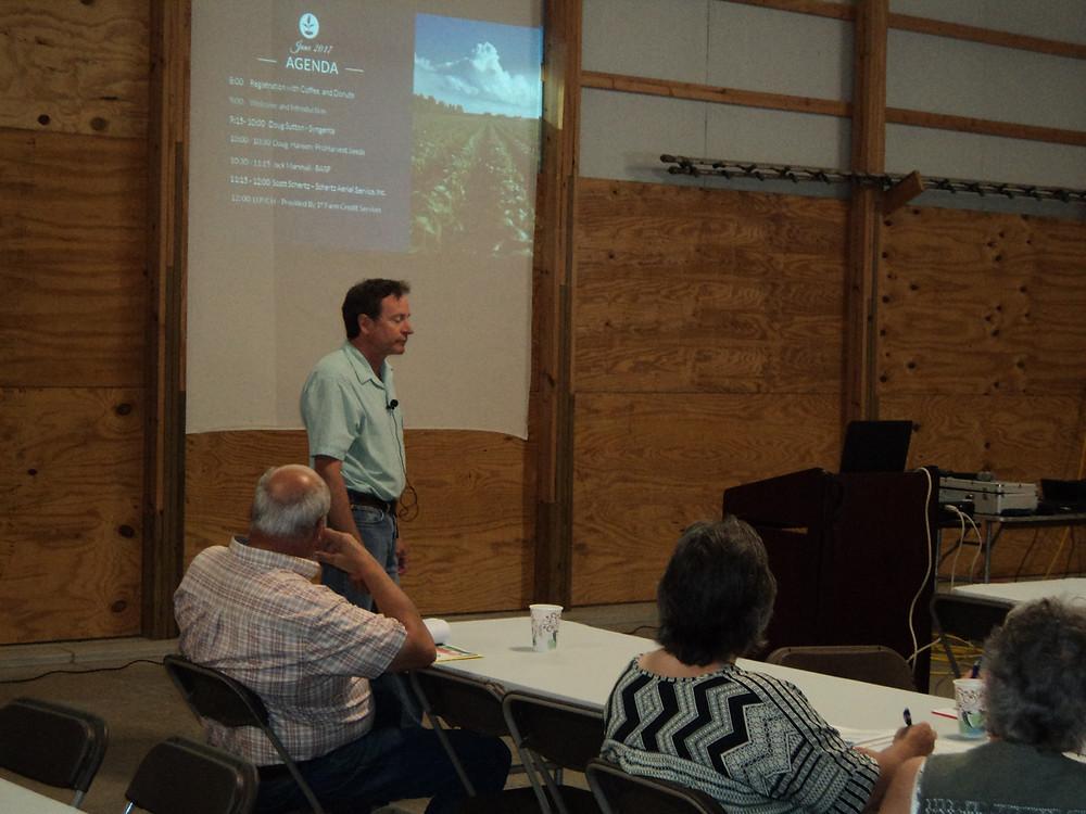 Scott Schertz presents information during a meeting near Cooksville last week / CIFN photo.