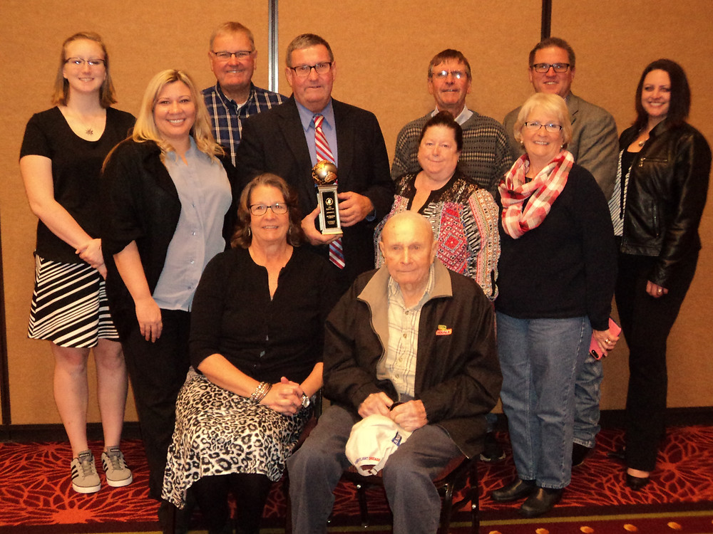 Art Bunting (center, holding award) is surrounded by family after receiving an award from ICGA in November / CIFN photo.