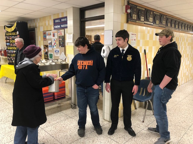 A woman donates to the Pontiac FFA before enjoying a meal Saturday afternoon / CIFN photo.