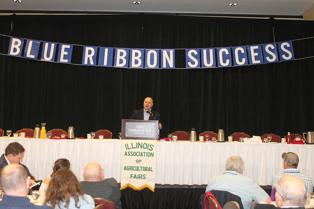 Aaron Alejandro addresses the IAAF annual meeting in Springfield on Saturday morning / CIFN photo by Rebecca Casson.