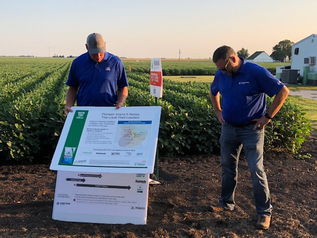 Corteva reps discuss soybean varieties during the Atkins Seed Service plot night / CIFN photo.