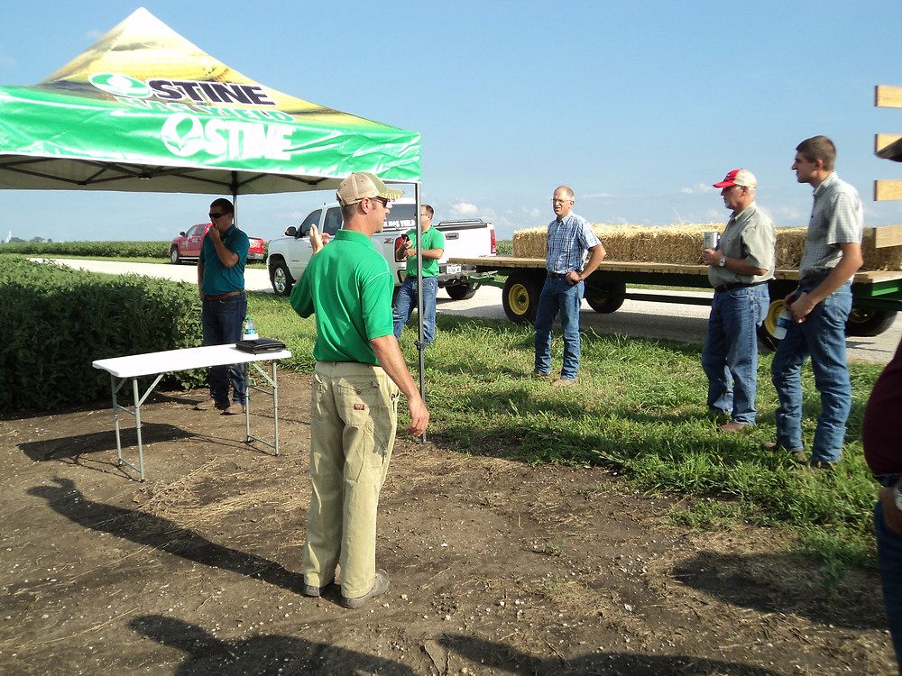 Chuck Vaughan of Stine Seed visits with area growers at Blake Zehr's farm south of Fairbury / CIFN photo.
