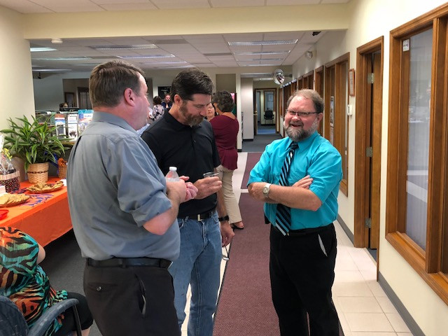 Gary Bressner visits during an open house in his honor at State Bank of Graymont (Pontiac branch) Wednesday / CIFN photo.