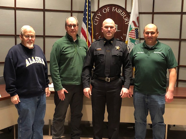 Lynn Dameron (council member), David Hammer (Prairielands Foundation), Mark Travis (police chief) and Dave Slagel (mayor) pose following the recent Fairbury City Council meeting / EOCI photo.