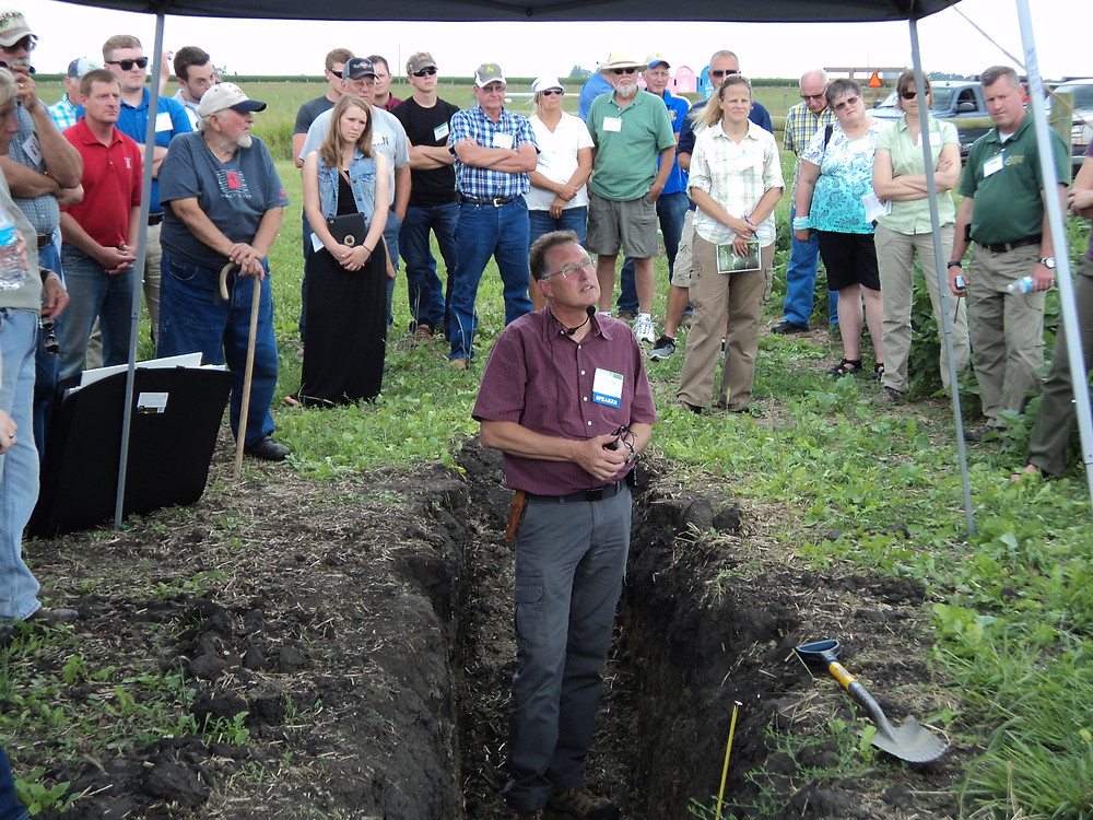 Soil structure is examined during the Indian Creek Watershed Tour on the Terry Bachtold farm / CIFN photo.