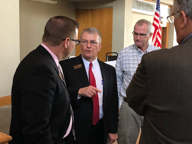 State Rep. Tom Bennett chats with LCFB members Monday in Pontiac / CIFN photo.