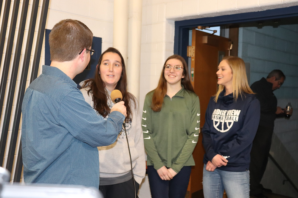 Ridgeview FFA reps talk with Kent Casson on Saturday in Colfax / CIFN photo.