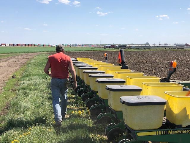 A McLean County farmer loads his planter near Lexington Monday afternoon / CIFN photo.