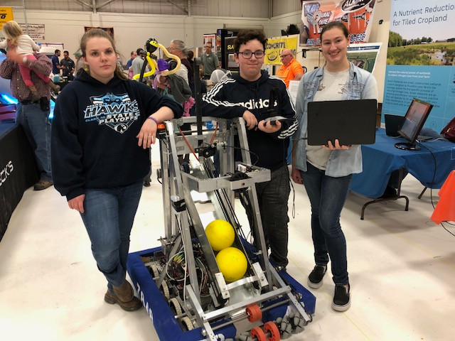Payge Shanks, Eric Jones & Allison Pratt with their robot at last weekend's Farm & Home Show / CIFN photo.