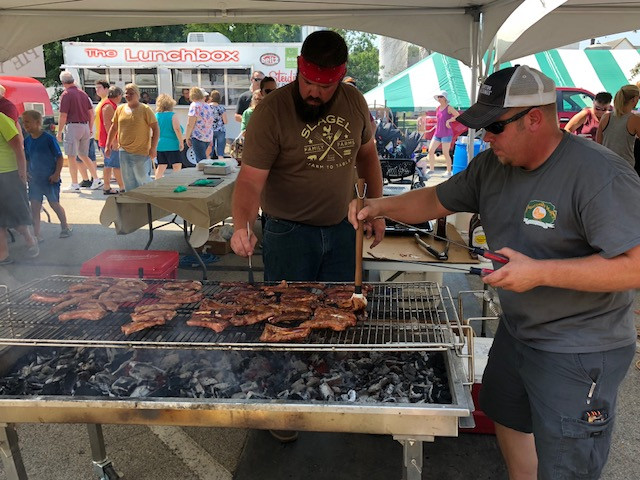 """Cooks prepare ribs from Slagel Family Farm at Saturday's """"A Local Taste: Flavors from the Farm."""""""
