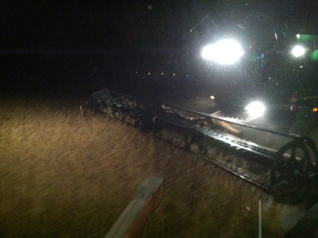 A farmer harvests soybeans in McLean County Monday night / CIFN photo.
