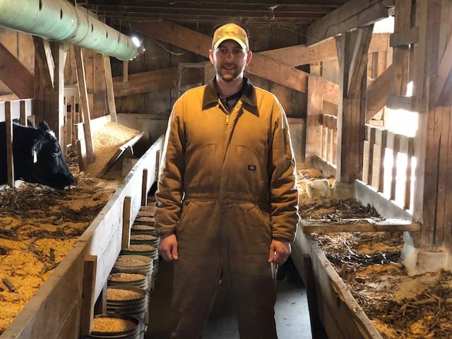 Craig Davis poses in his barn near Strawn in Livingston County last week / CIFN photo.