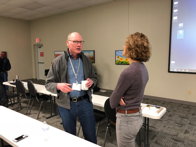 IFCA's Jean Payne, right, visits with Dr. Greg McIsaac at a 4R Field Day this month in Bloomington / CIFN photo.