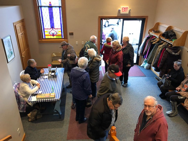Visitors wait at the McDowell Methodist Church pancake and sausage stuffer Thursday / EOCI photo.