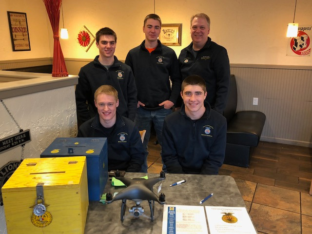 PC FFA members and their advisor, Kyle Miller, sell raffle tickets at McDonald's Family Restaurant this week / CIFN photo.