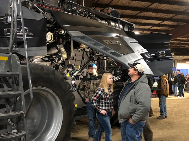 Spectators take a look at the new Fendt combine displayed last week at the Gordyville farm show / CIFN photo.
