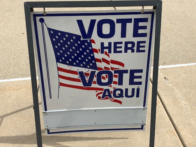 A voting sign is shown in Bloomington-Normal Tuesday / EOCI photo.