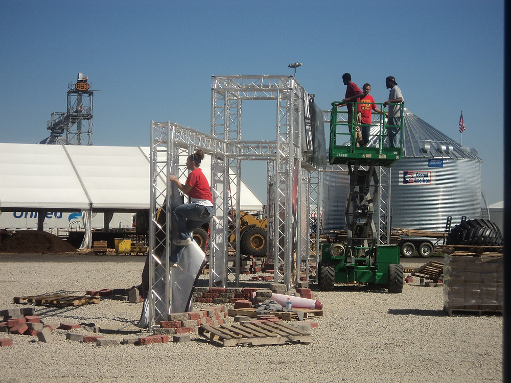 Crews set up displays Wednesday for next week's Farm Progress Show in Decatur / CIFN photo.