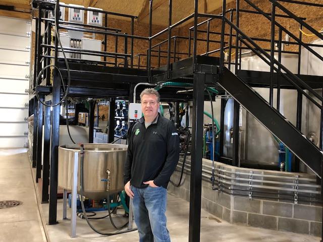 Don Brucker is shown near the bulk fill area of the new BCS Gibson City facility last week / CIFN photo.