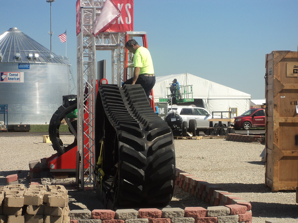 A man sets up an exhibit for this week's Farm Progress Show in Decatur / CIFN photo.