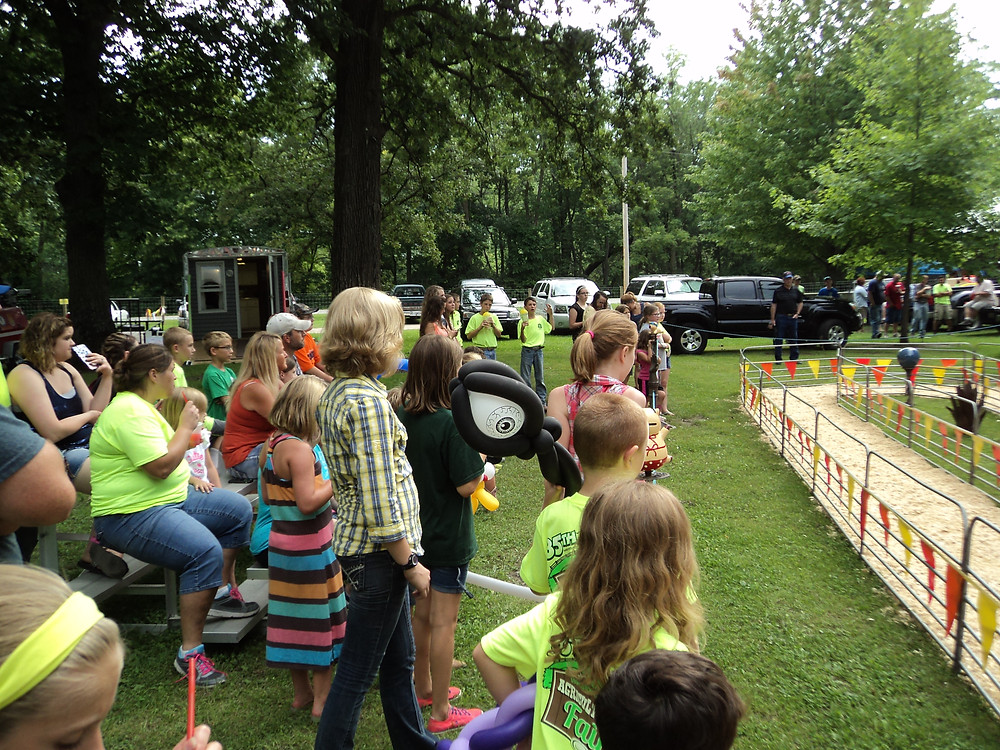 Visitors to the 2015 Livingston County Ag Fair enjoy the pig races / CIFN file photo.
