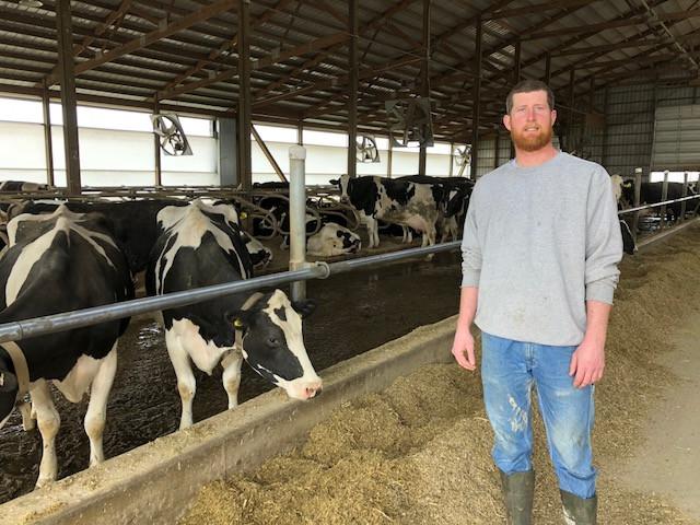 Jesse Mackinson poses on his dairy farm near Pontiac recently / CIFN photo.