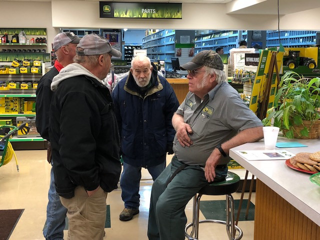 Kenny Gallup visits with local farmers Friday at KSR in Pontiac during a retirement open house / CIFN photo.