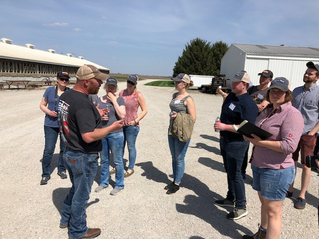 Kent Blunier of Forrest talks to German farmers on his operation in Livingston County this week / CIFN photo.