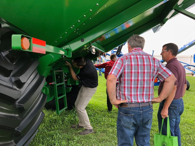 Visitors to the Farm Progress Show examine a grain cart from Brandt / CIFN photo.