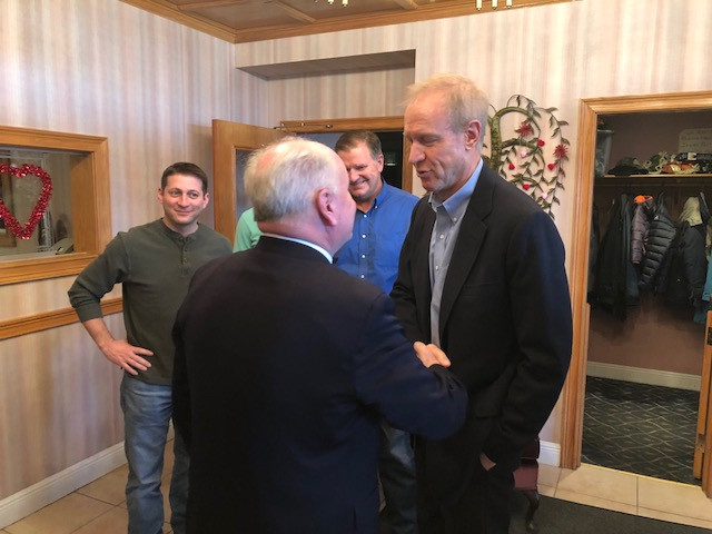 Governor Bruce Rauner greets State Rep. Dan Brady at a meeting in Pontiac.