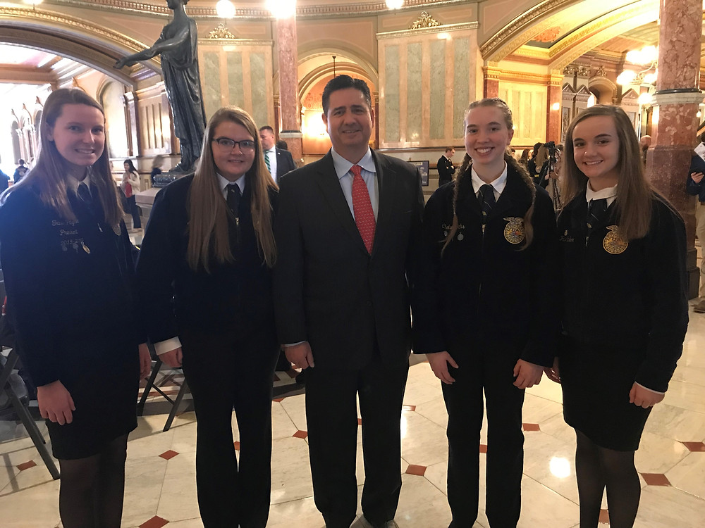 IDOA acting director Jerry Costello, center, with FFA members at the State Capitol / photo via IDOA.