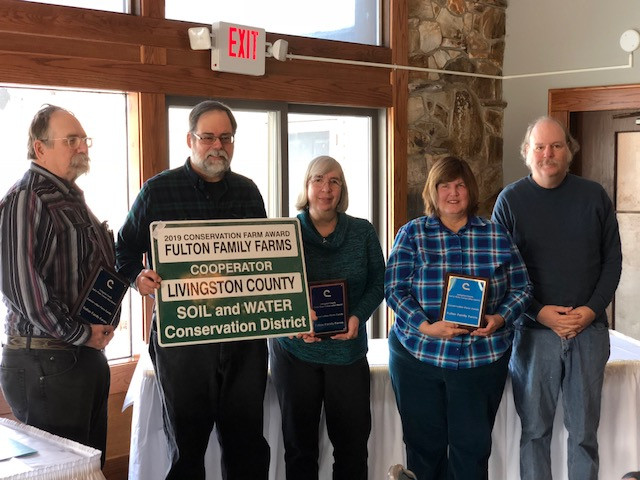 The Fulton family receives the conservation family award by the Livingston County Soil and Water District last week / CIFN photo.