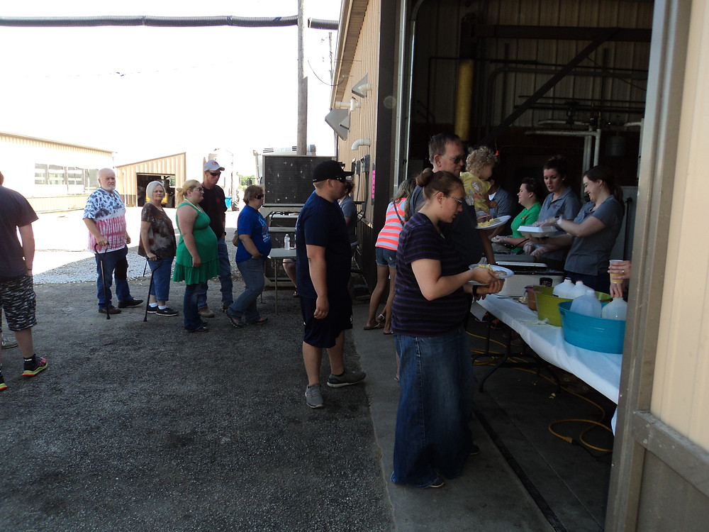 People wait for breakfast Saturday morning at Kilgus Farmstead near Fairbury / CIFN photo.