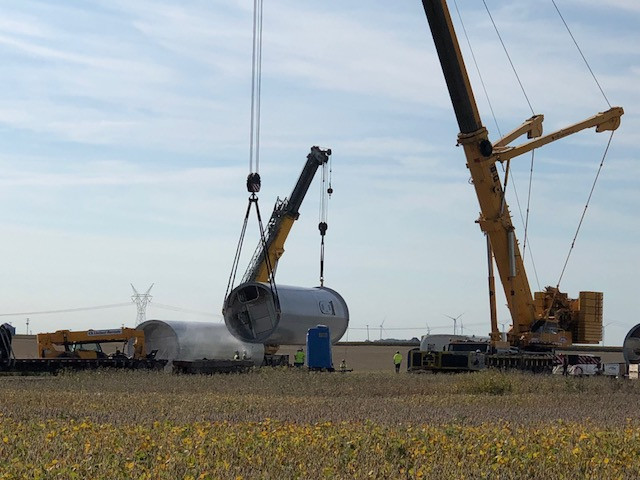 The base of a wind turbine is set by workers at the Bright Stalk Wind Farm near Chenoa last week / CIFN photo.